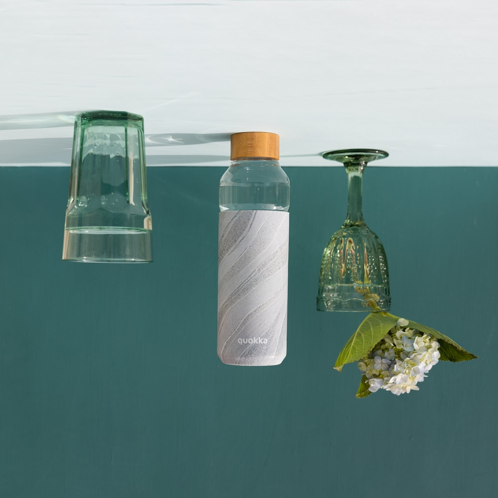 clear glass bottle with brown wooden lid