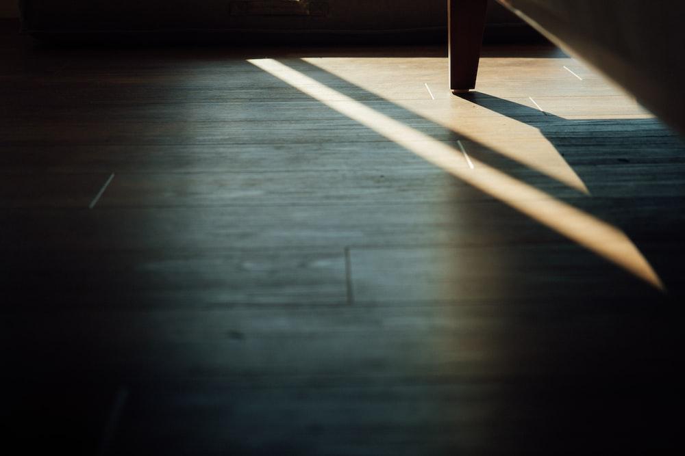 brown wooden bench on brown wooden floor