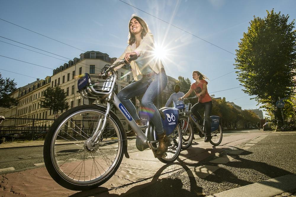 2 women riding on bicycles during daytime