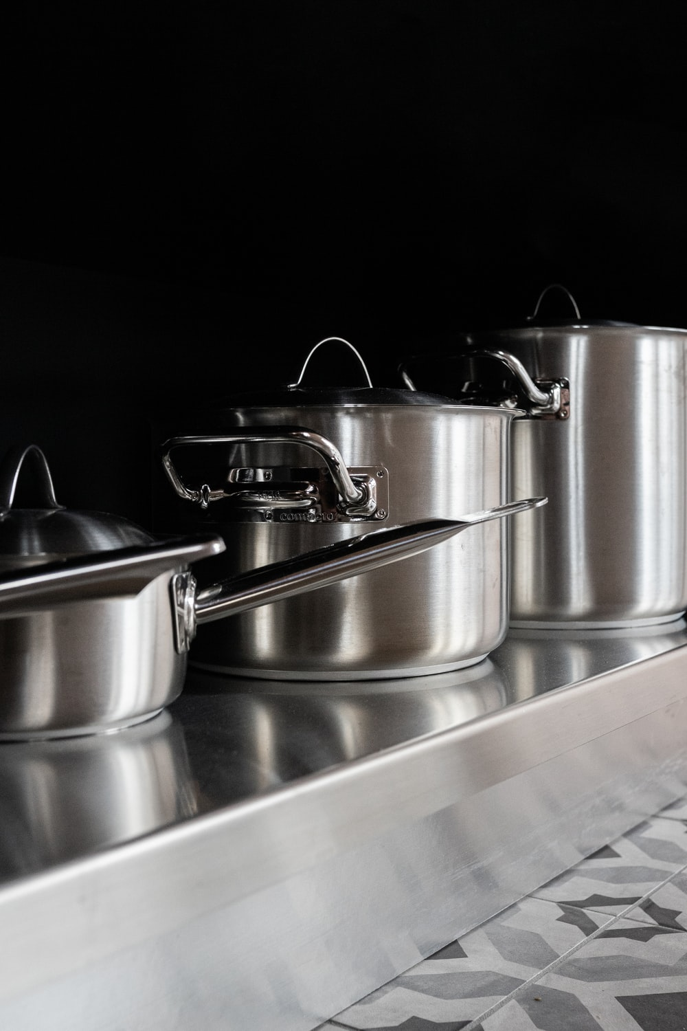 stainless steel cooking pots on stainless steel tray