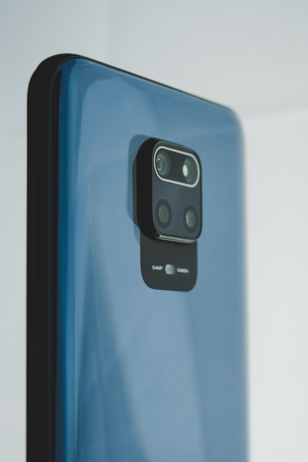 black and blue smartphone on white table