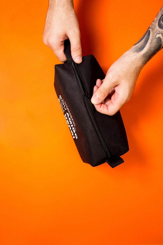 black and orange zip pouch