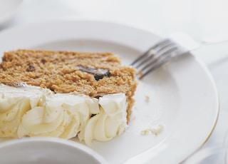 pasta with white cream on white ceramic plate