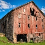 brown wooden barn under blue sky during daytime