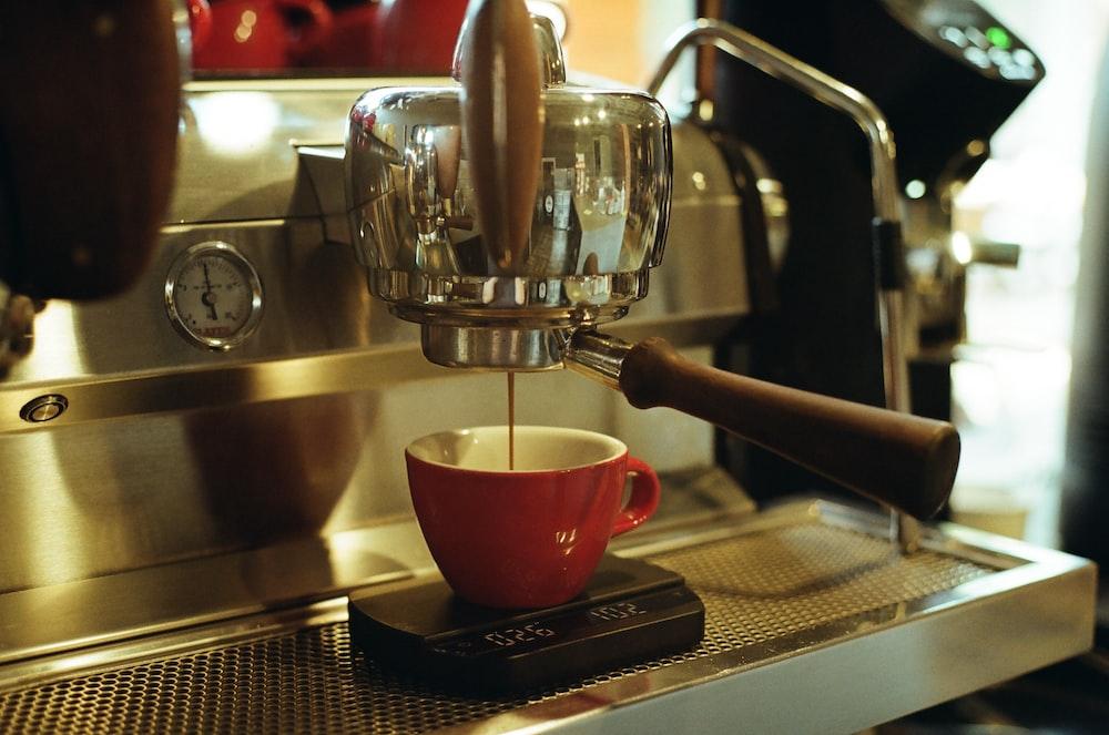 silver and black espresso machine