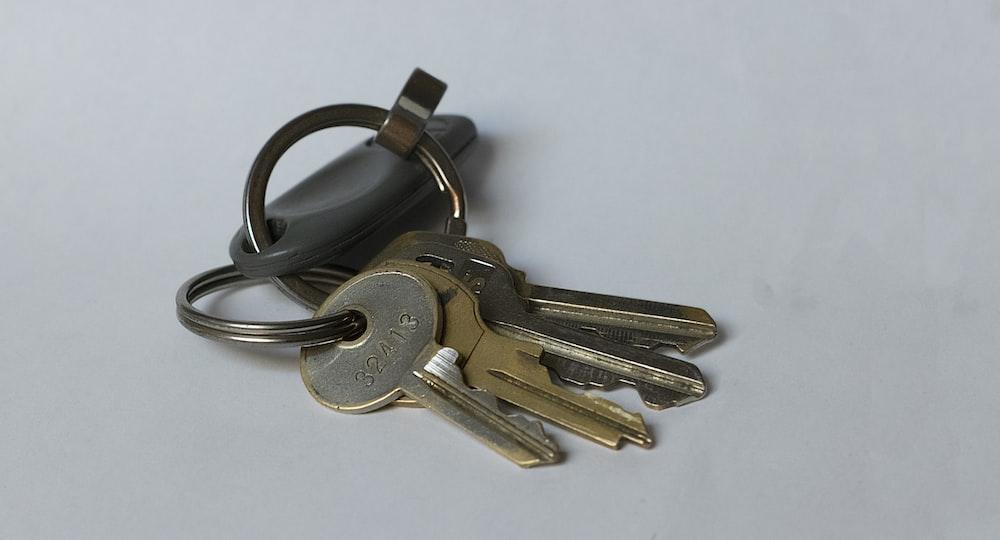 silver keys on white table