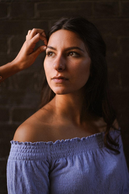 woman in blue off shoulder shirt
