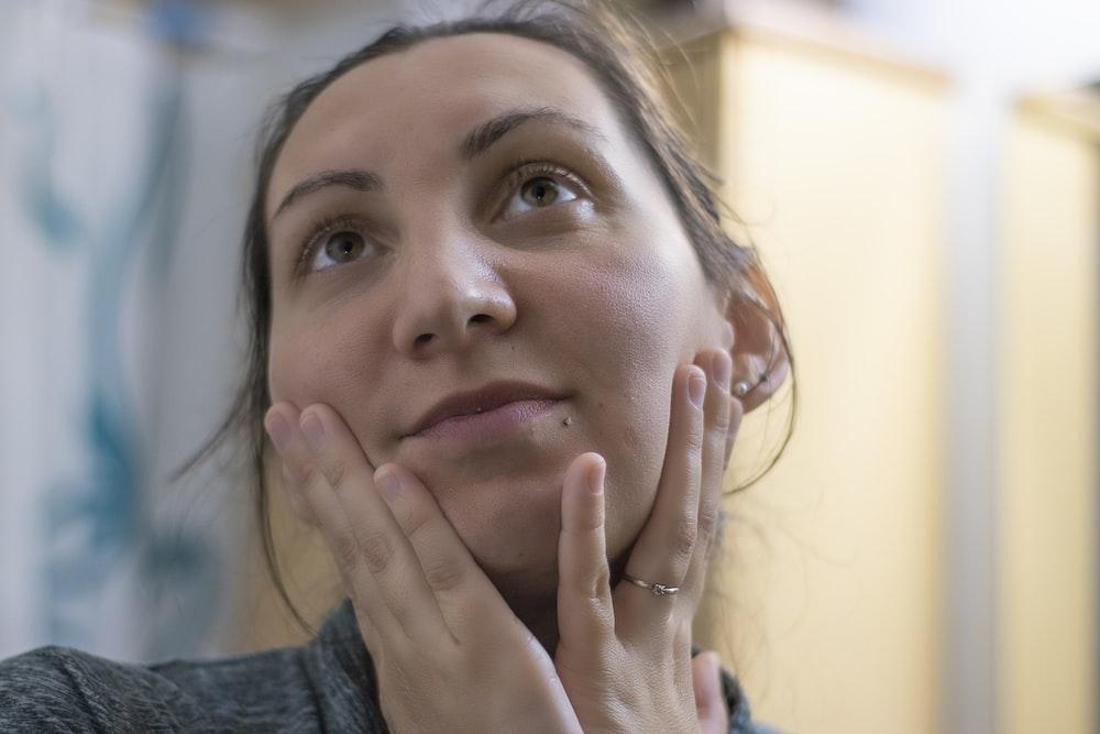 woman in gray crew neck shirt