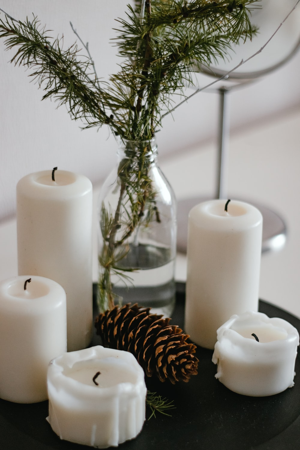 white pillar candles on clear glass candle holder