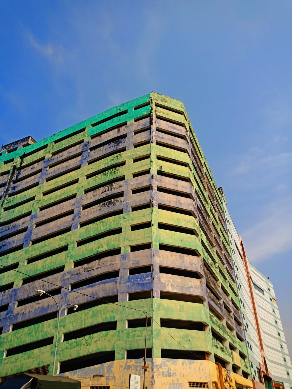 green and white concrete building under blue sky during daytime