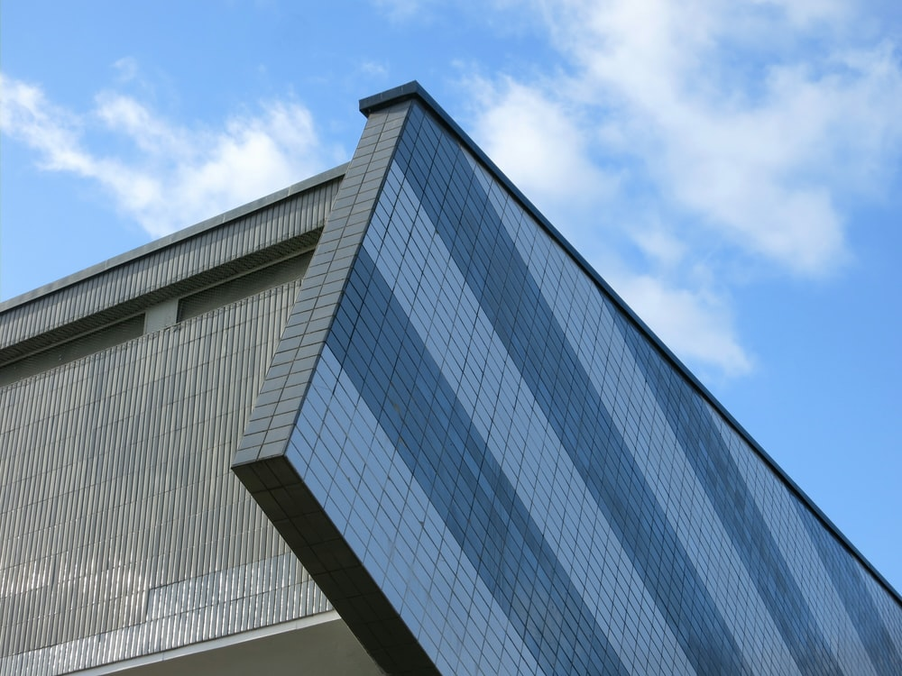 gray and black concrete building under blue sky during daytime
