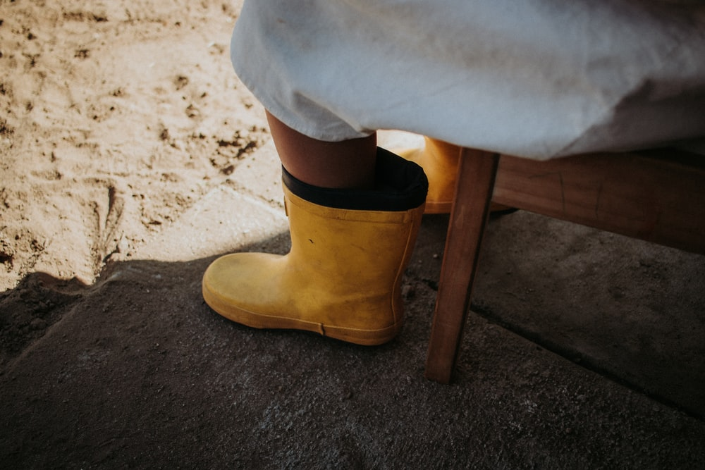 person wearing brown suede boots