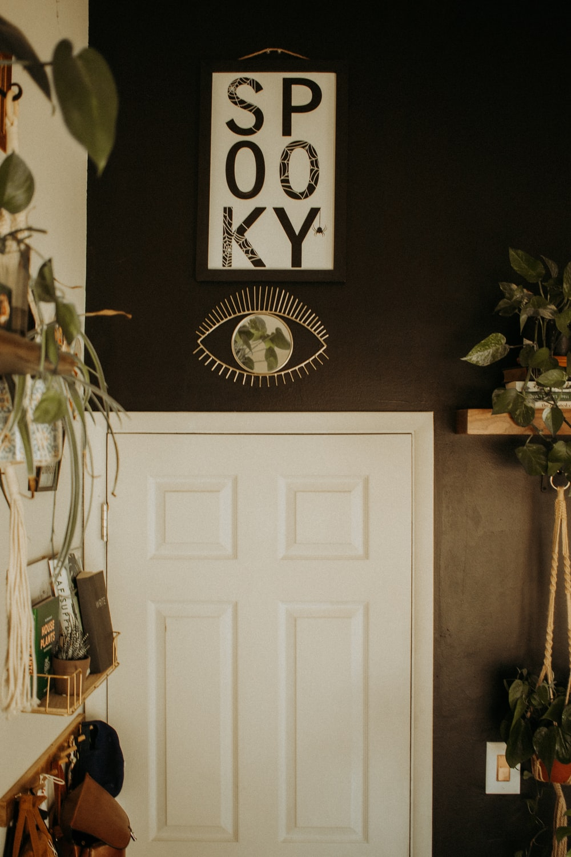 white wooden door near white wall