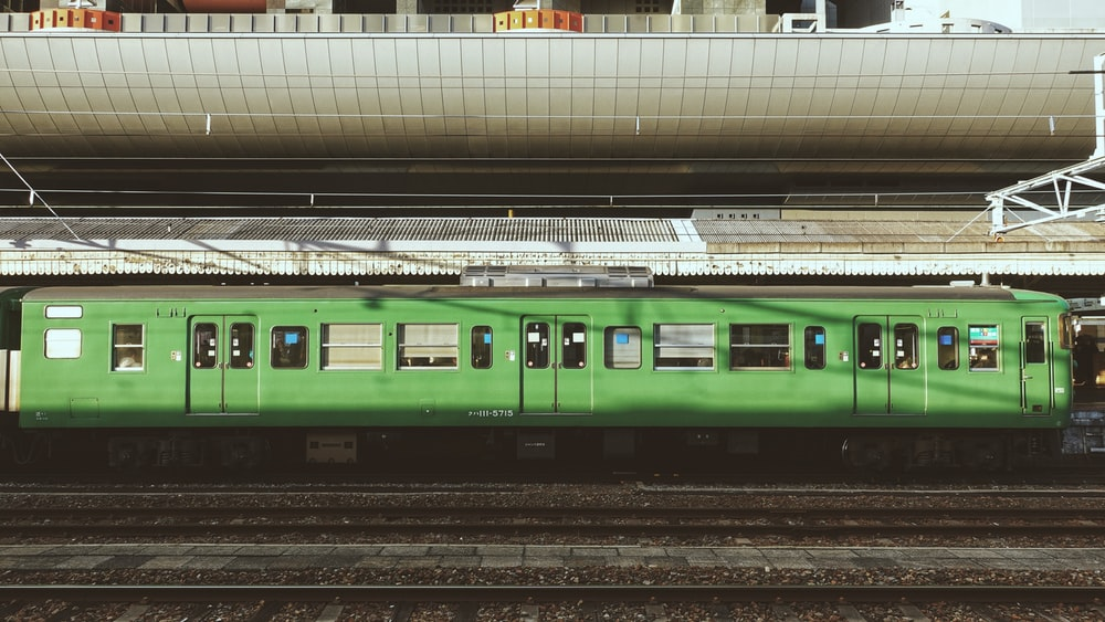 green train on train station