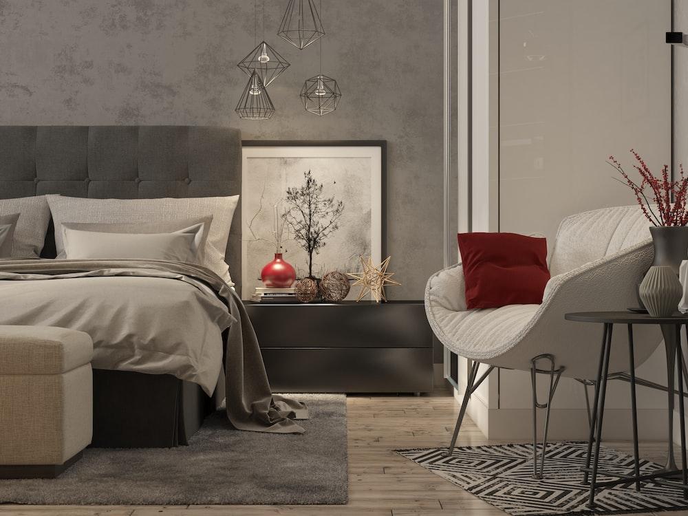 red throw pillow on white sofa
