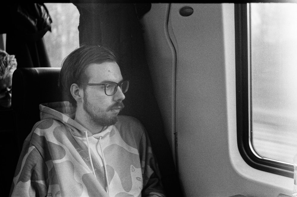 grayscale photo of man in eyeglasses and button up shirt