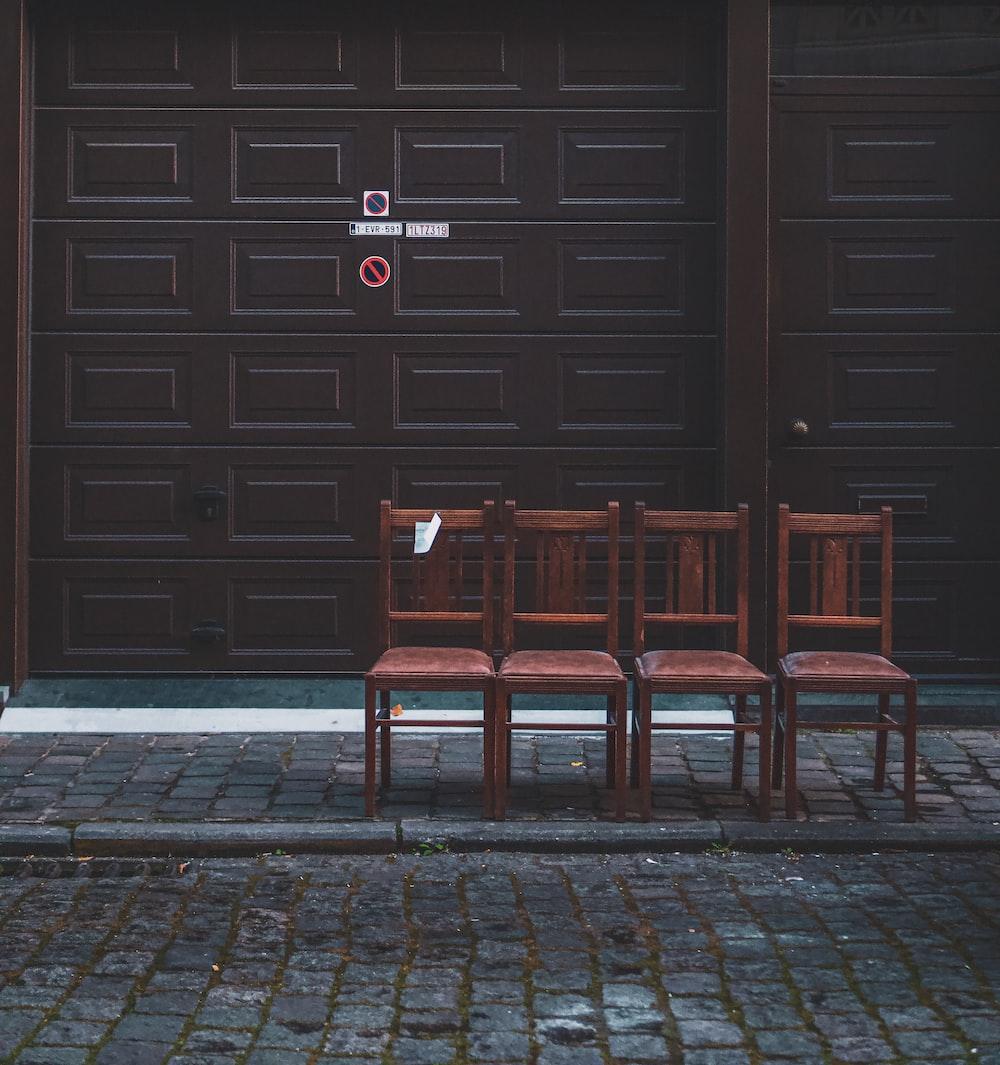 brown wooden chair on brown brick floor