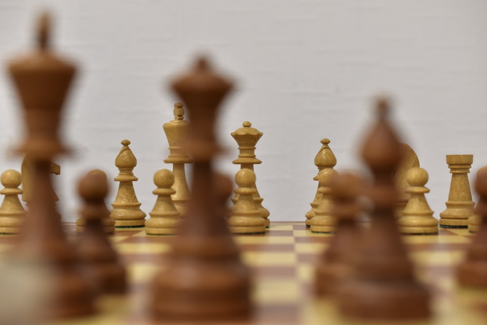 brown chess piece on white surface