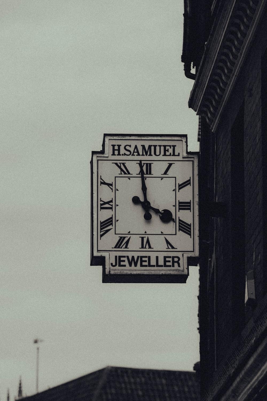 black and white analog wall clock