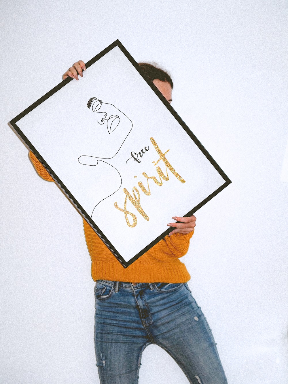 person holding white and black frame