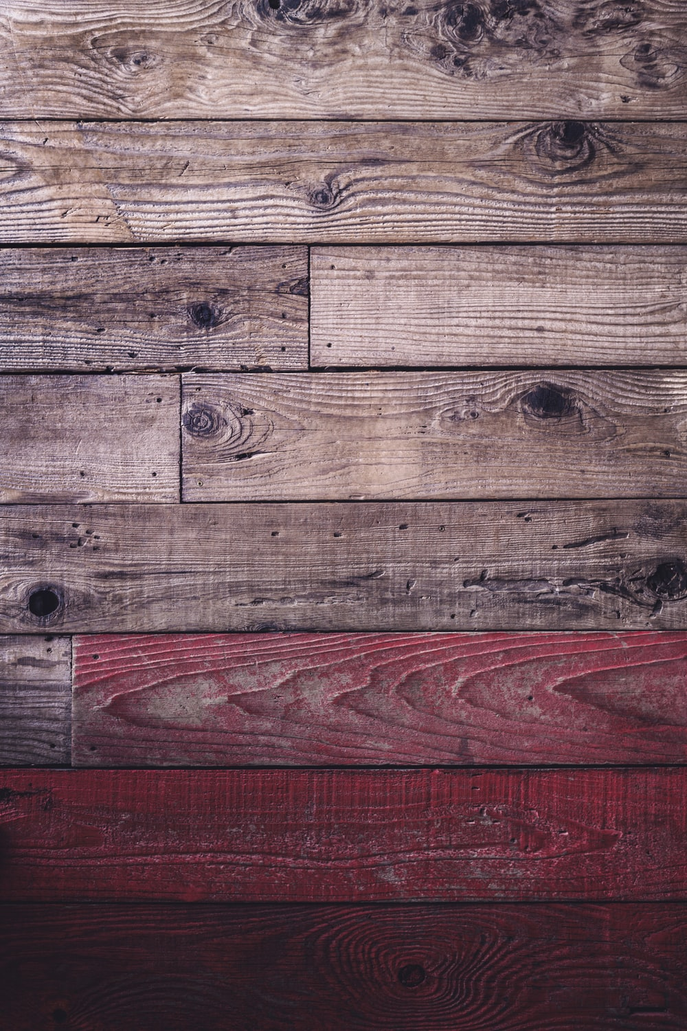 brown wooden plank with red paint