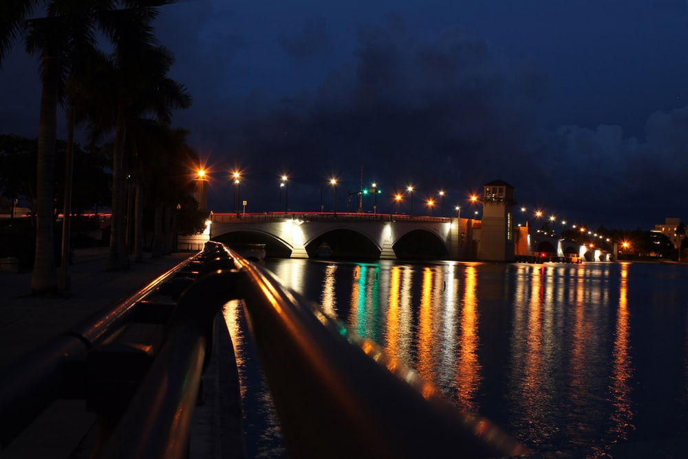 lighted bridge over river during night time