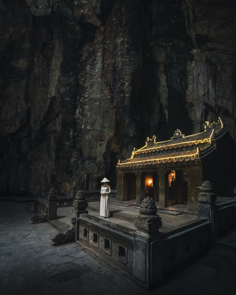 white and gold temple on gray rock formation