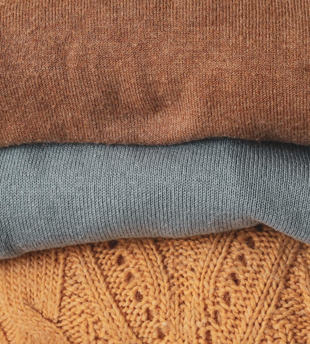 gray sock on brown textile