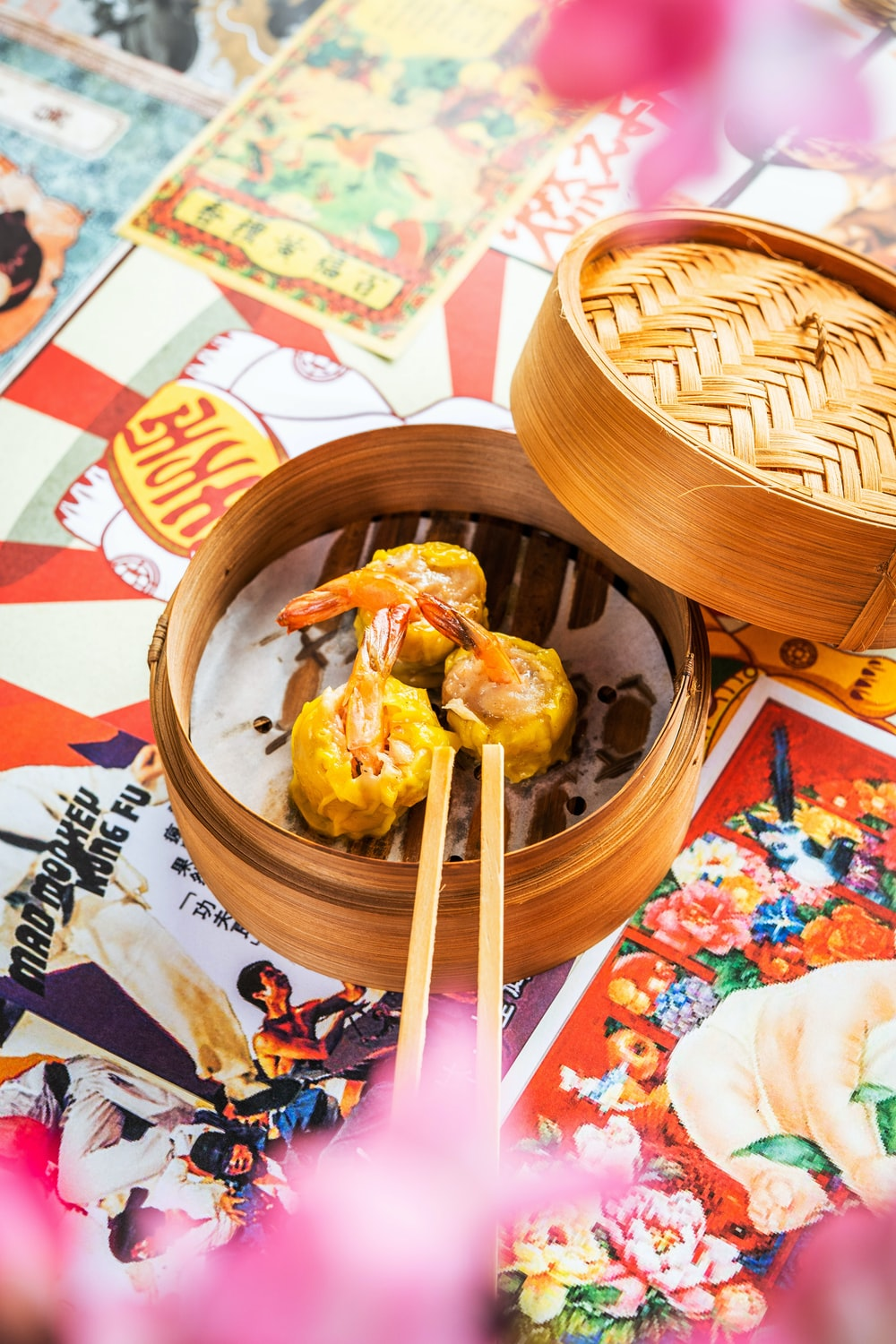 brown wooden bowl with rice and chopsticks
