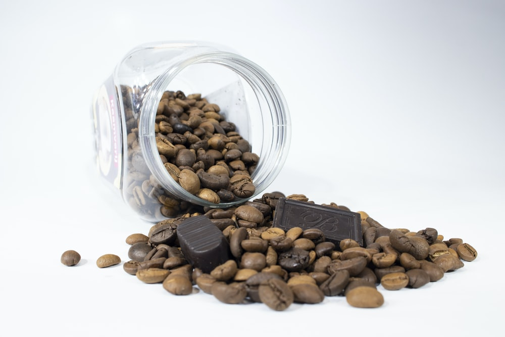 brown almond nuts in clear glass jar
