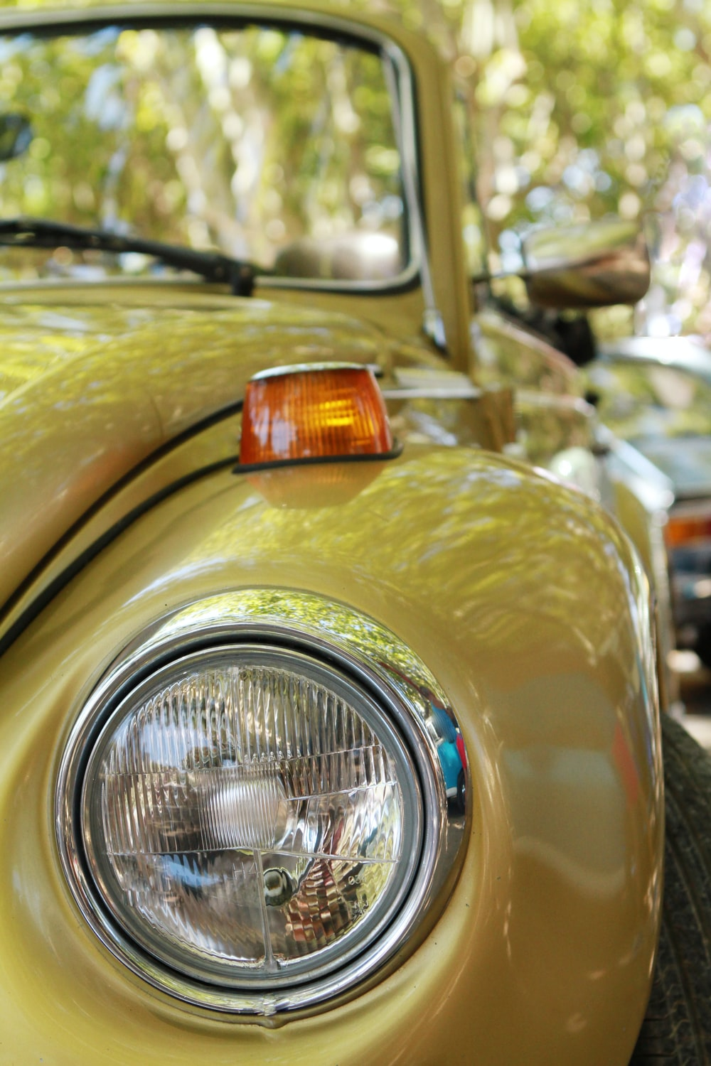 yellow car with silver headlight