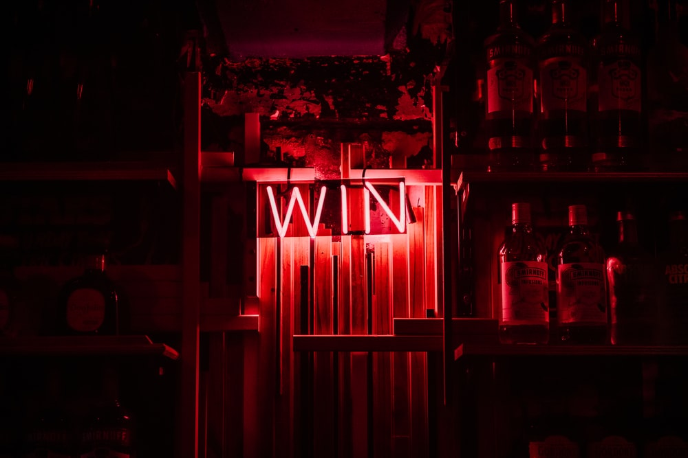 red and white neon light signage