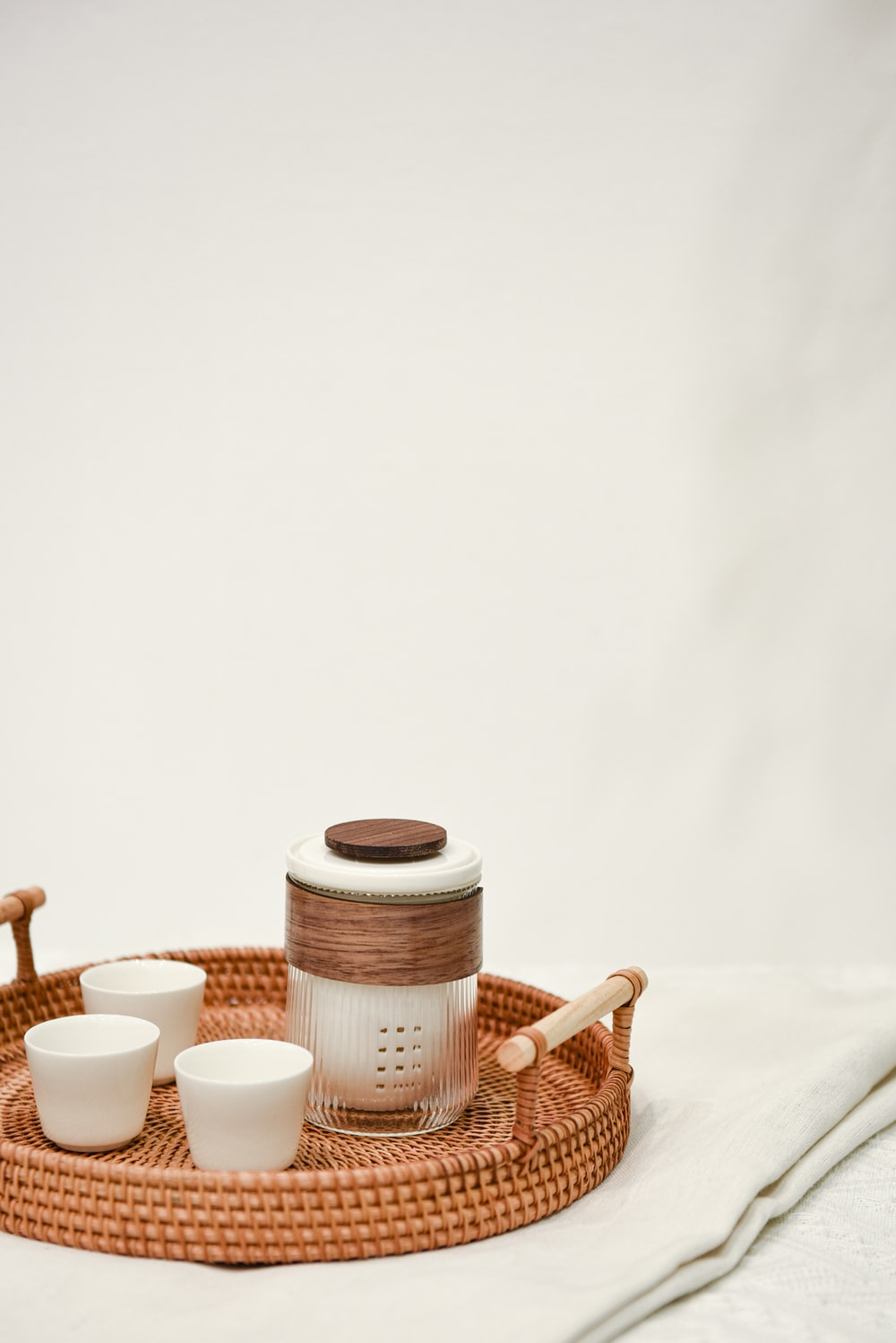 brown and white ceramic mugs on brown wooden table