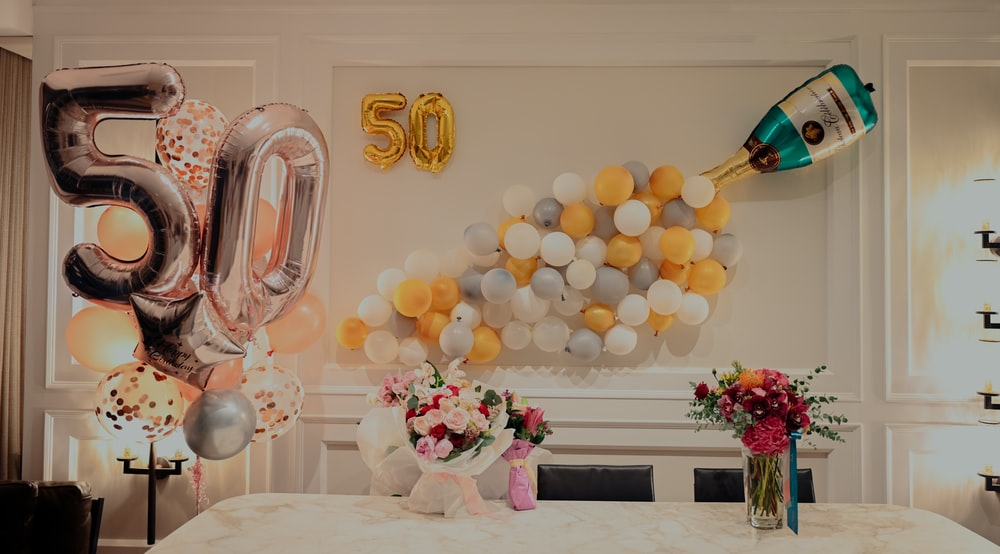 yellow and white balloons on table