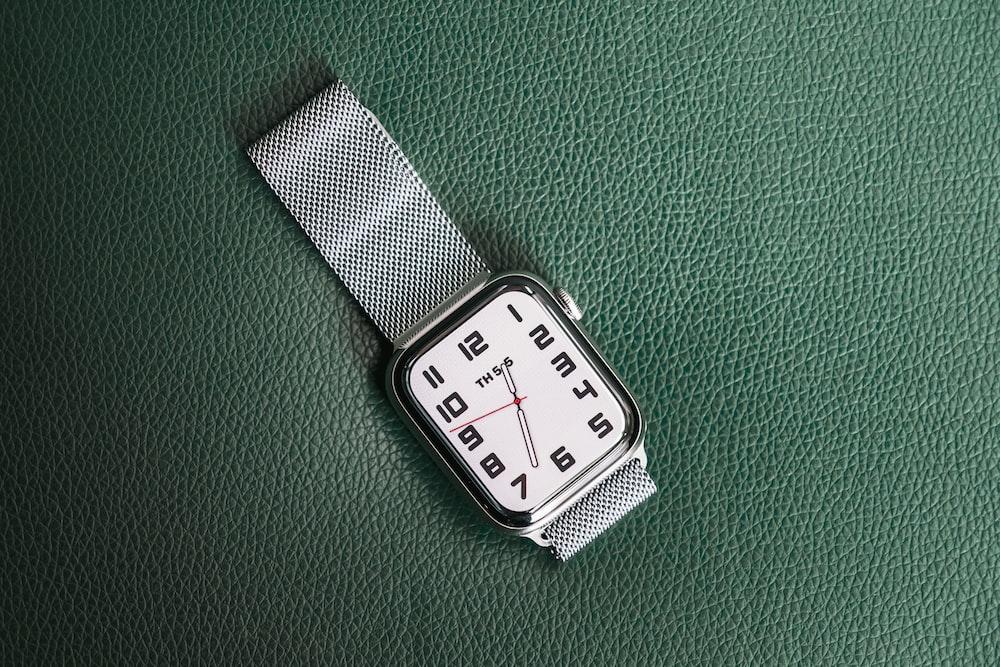 silver analog watch at 10 00