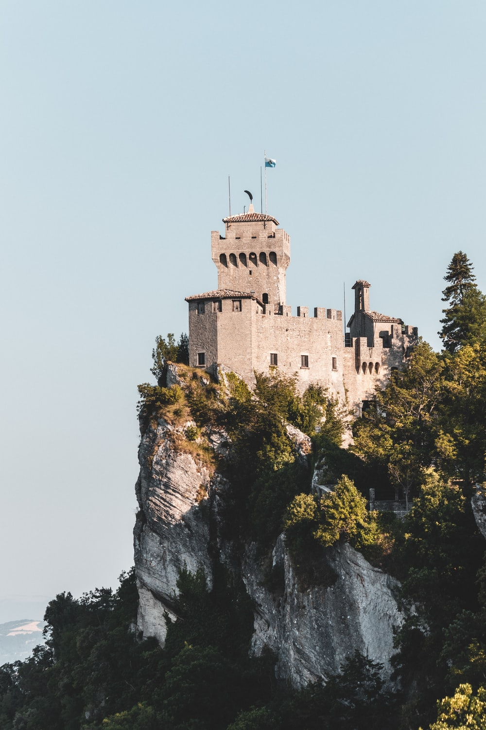 brown concrete castle on top of mountain