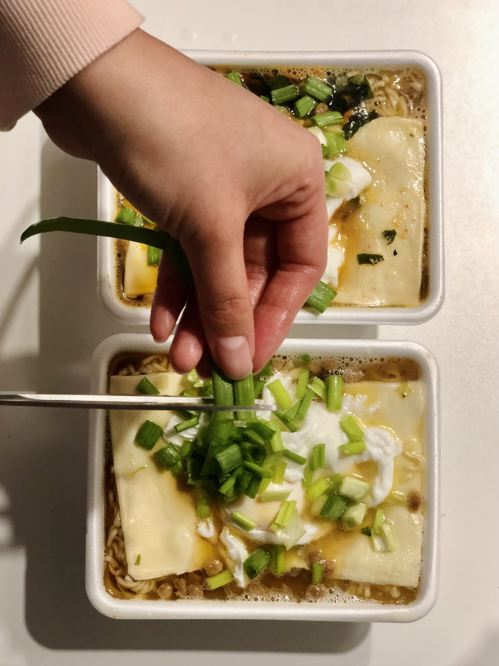 person holding green vegetable salad