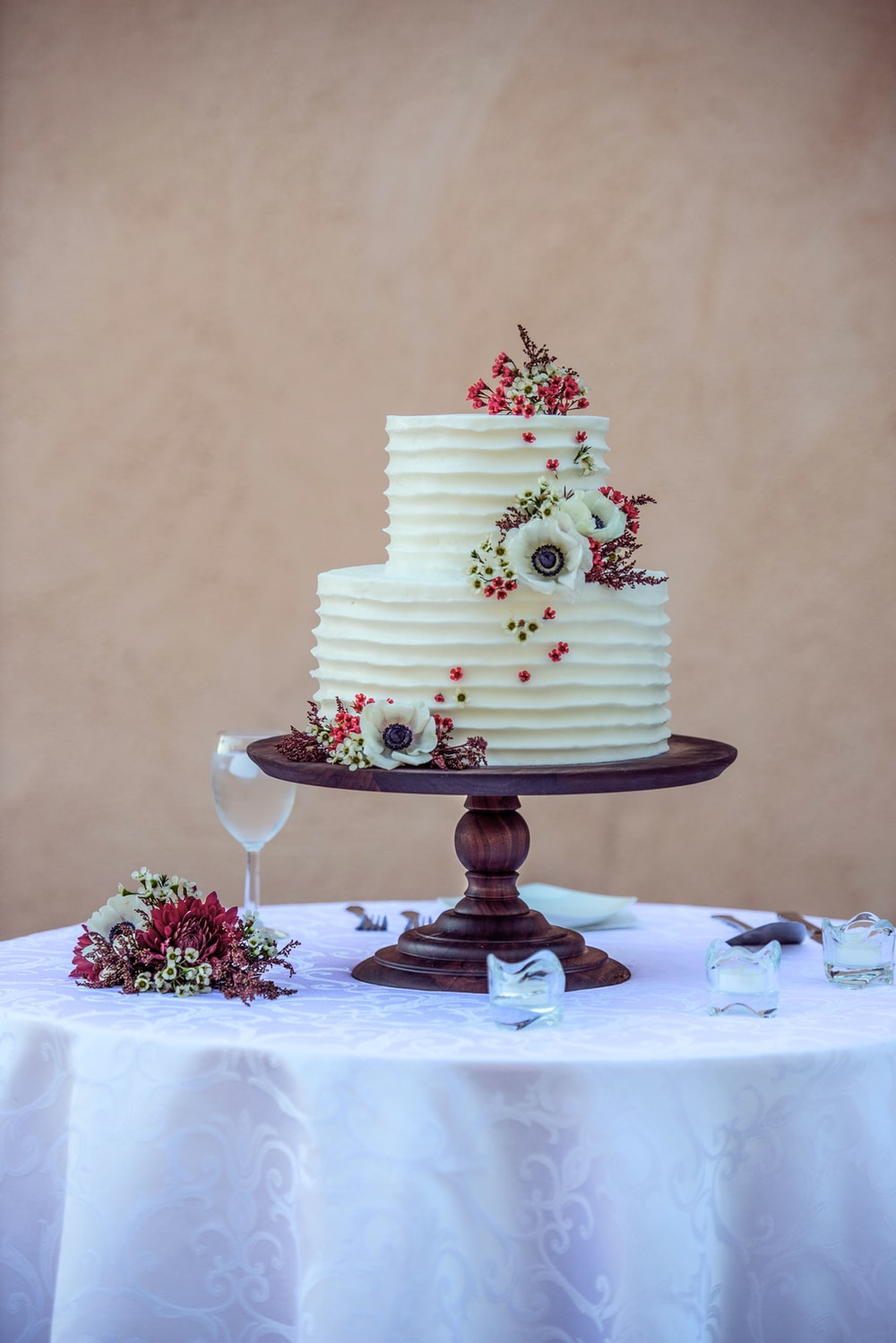 white and pink floral cake on white table