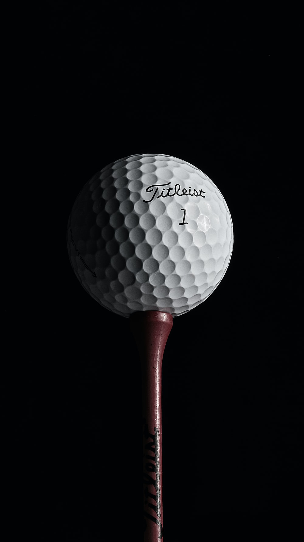 red and white golf ball