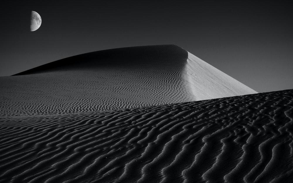 white sand under gray sky