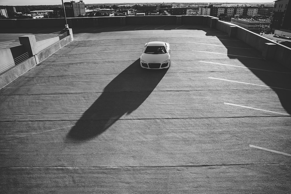 white sports car on road during daytime