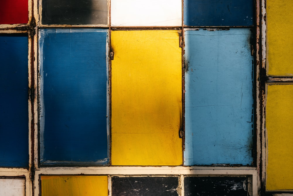 blue and yellow wooden cabinet