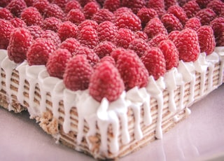 red and white cake on brown wooden tray