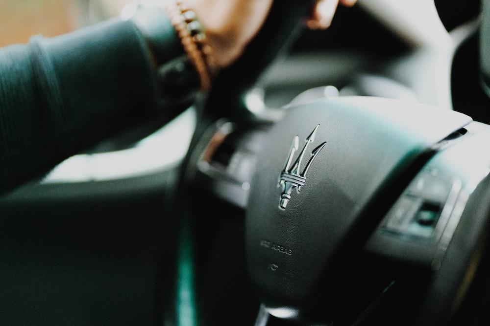 black and silver nissan car steering wheel