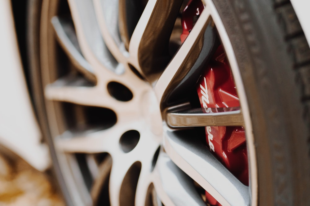 silver and red car wheel
