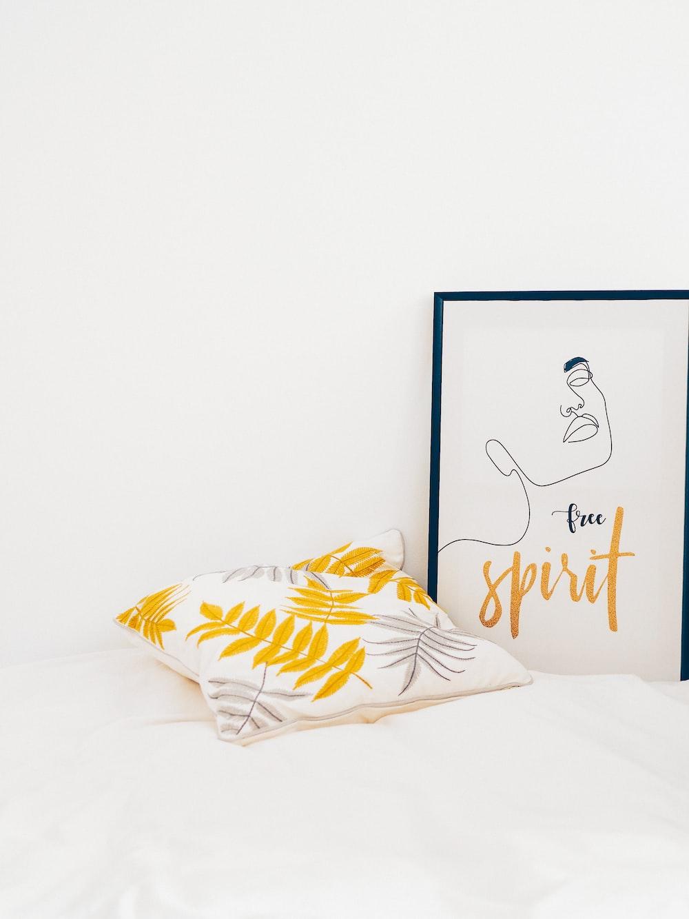 white and yellow throw pillows