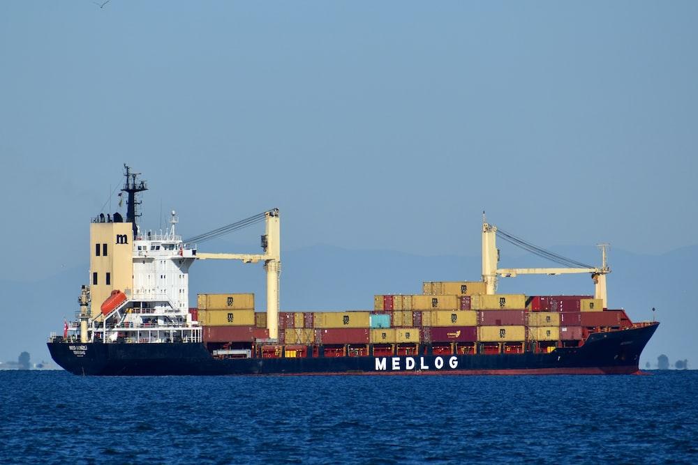 cargo ship on sea during daytime