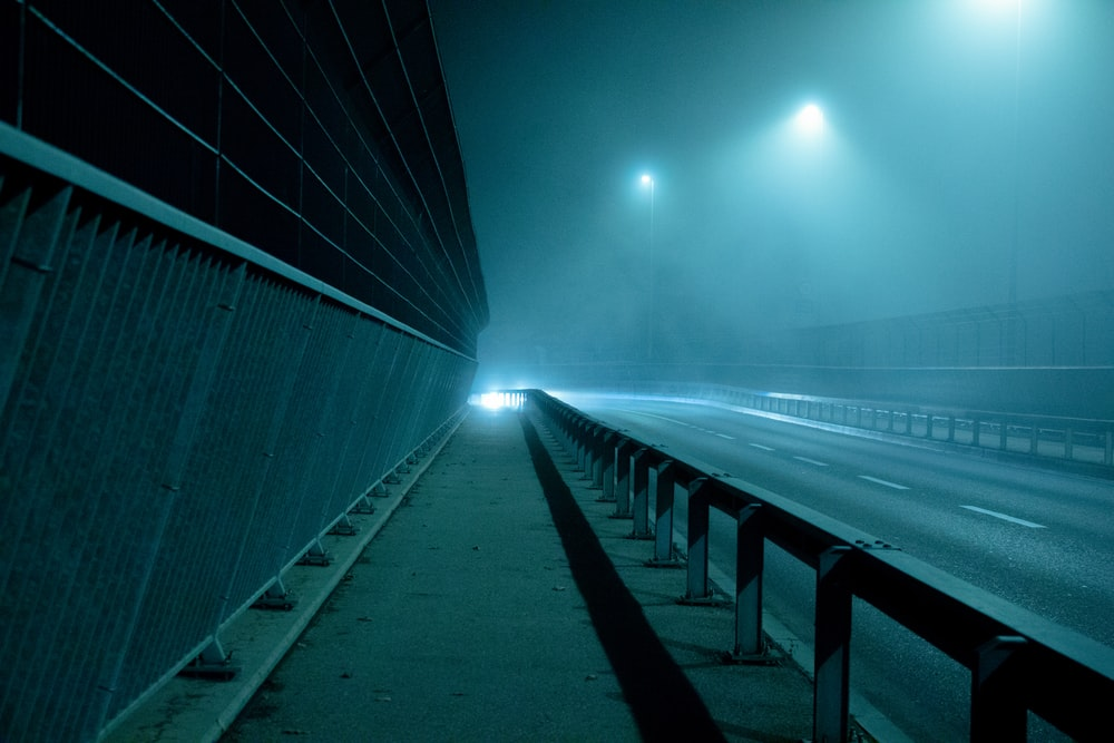 gray concrete bridge with light