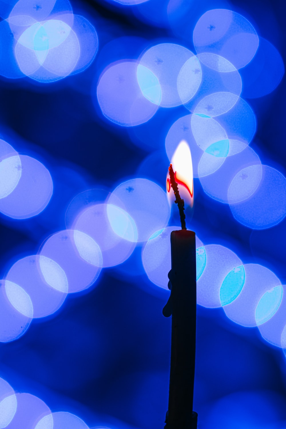 lighted candle in bokeh photography