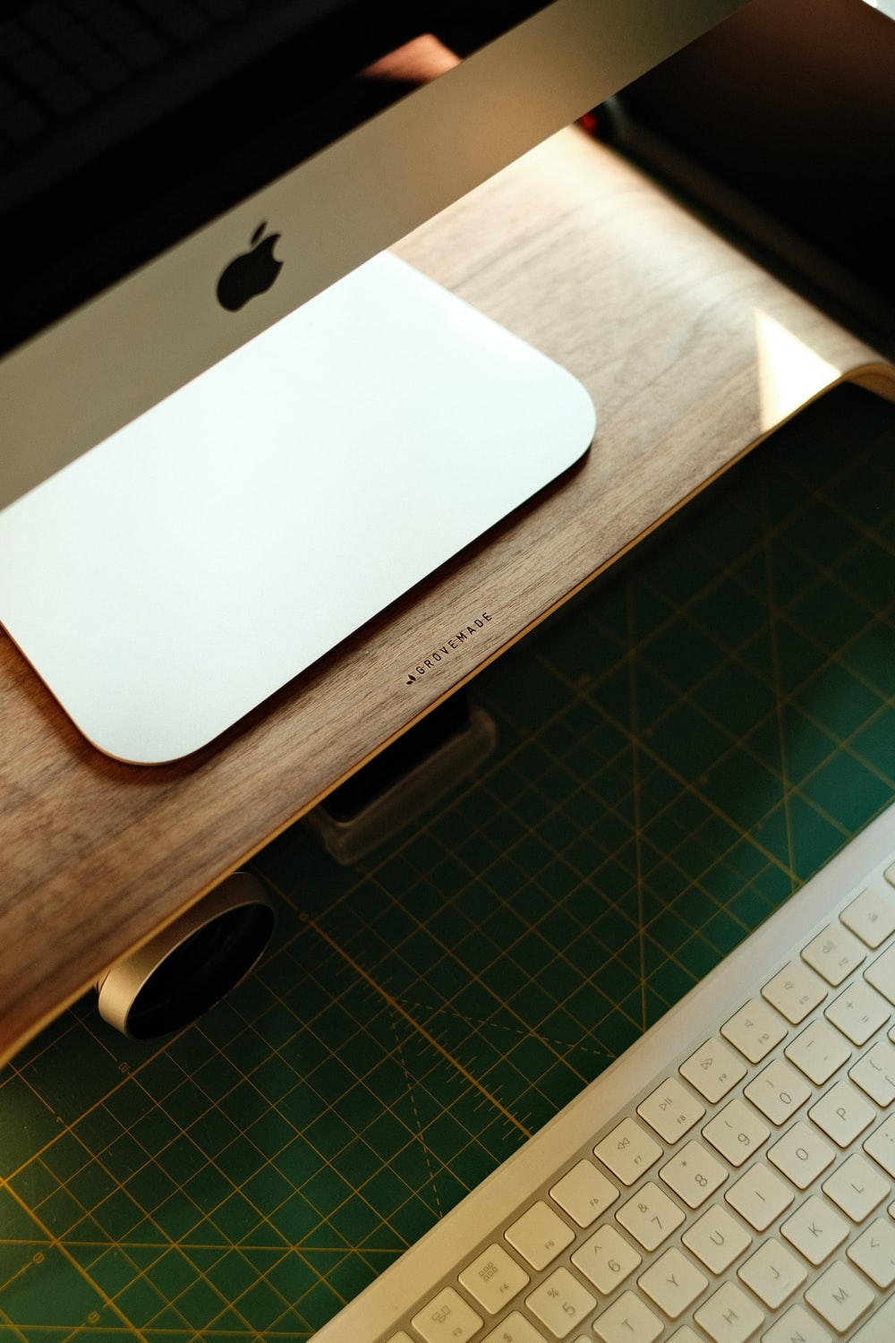 white apple magic keyboard on brown wooden table